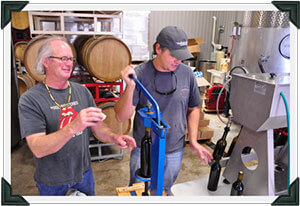 Bill and Chris Bottling Enchanté